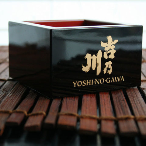 Black Yoshinogawa Masu Cup on sushi roll mat