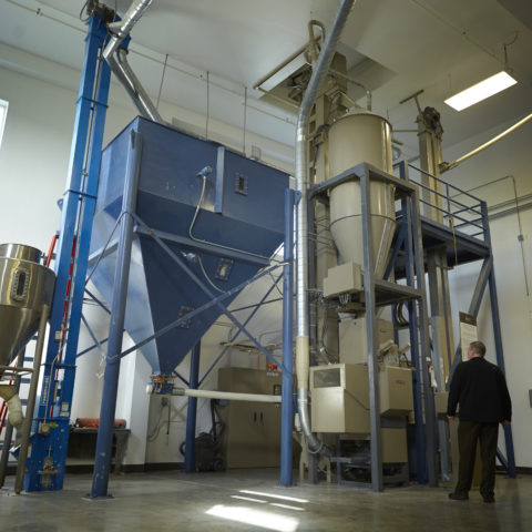 SakéOne's Blue Rice Milling Machine in their brewery