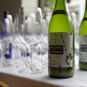 Momokawa Organic Junmai Ginjo on a tasting table