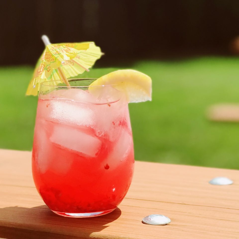 G Fifty Raspberry Lemonade cocktail on a picnic table