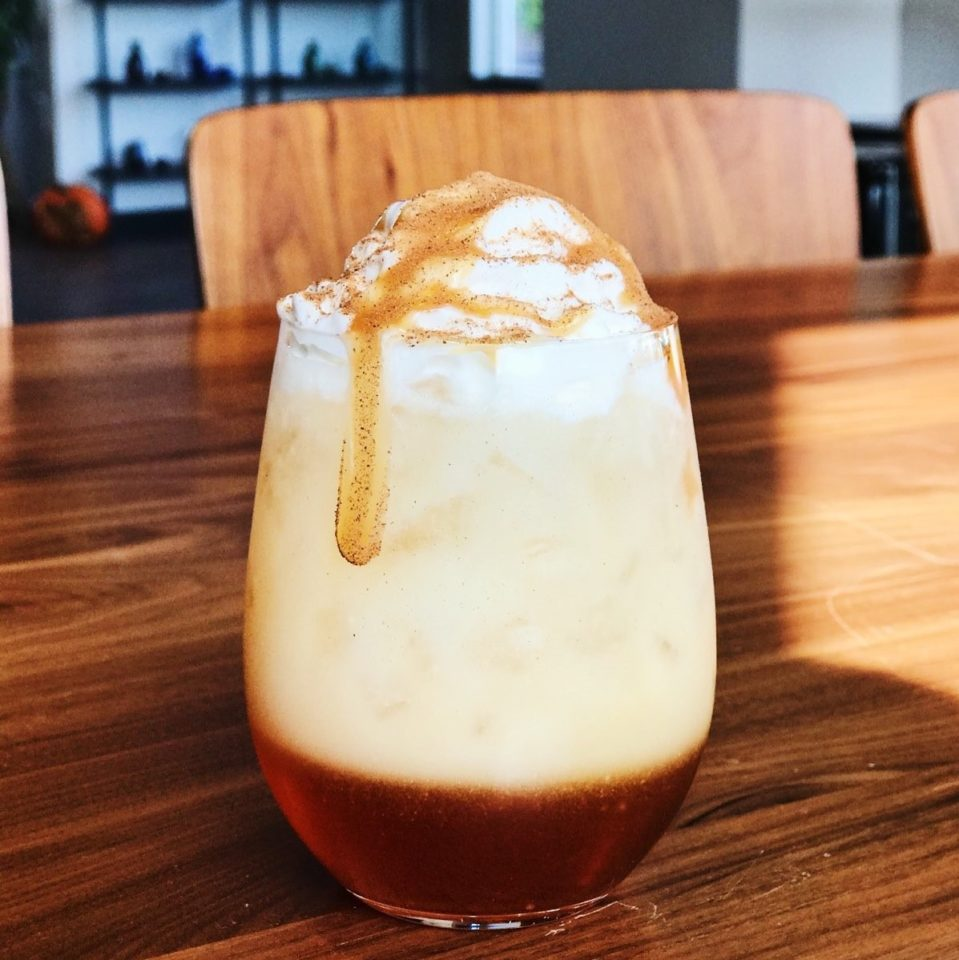 Pearl Caramel Iced Chai on a wooden table